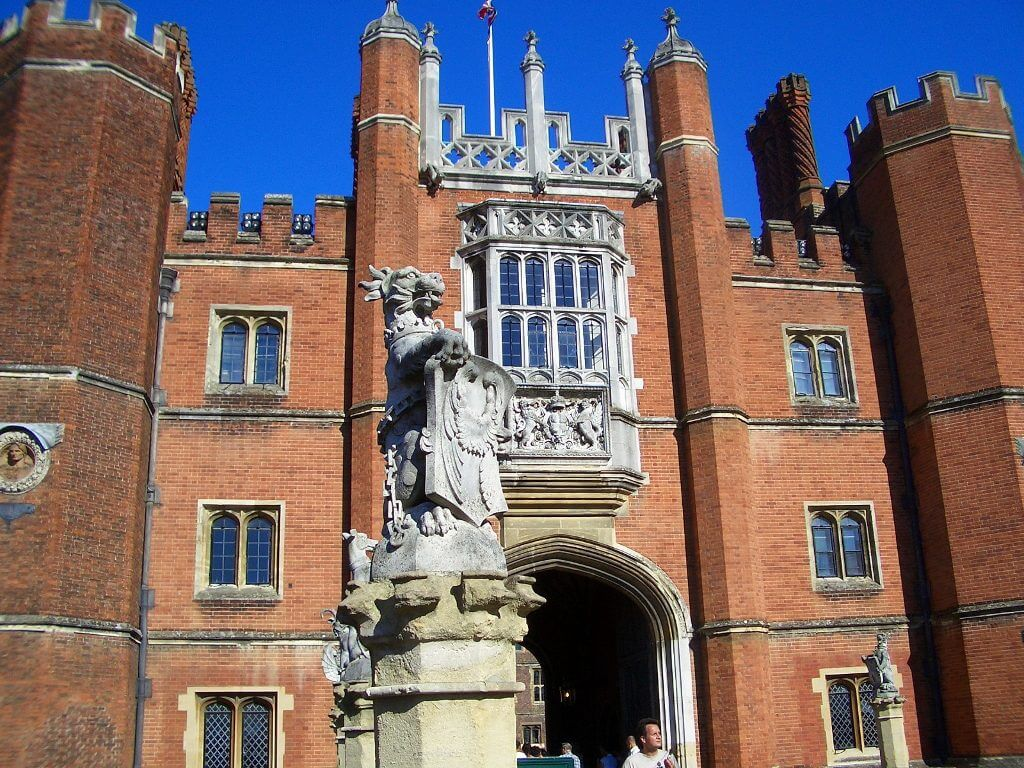 View of the medieval red brick facade of Hampton Court Palace