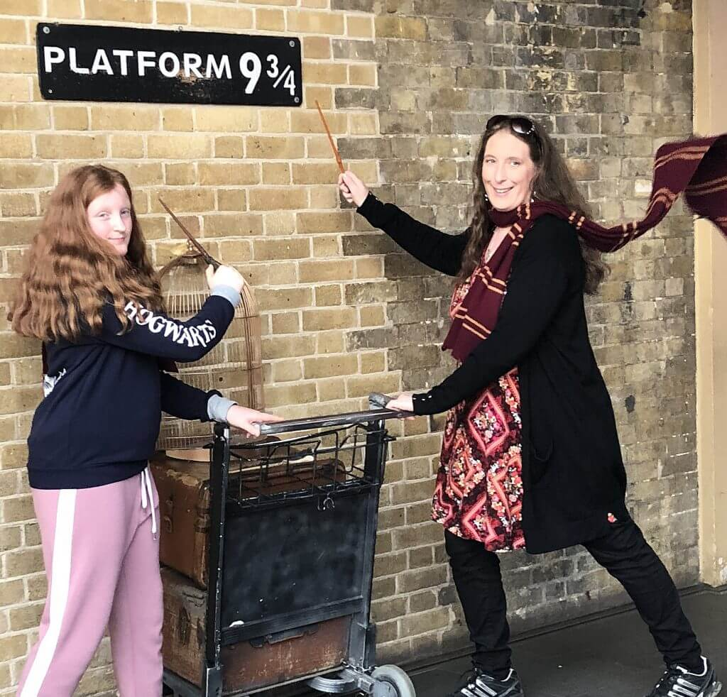 Mother and daughter with baggage trolley at Harry Potter's Platform 9 3/4