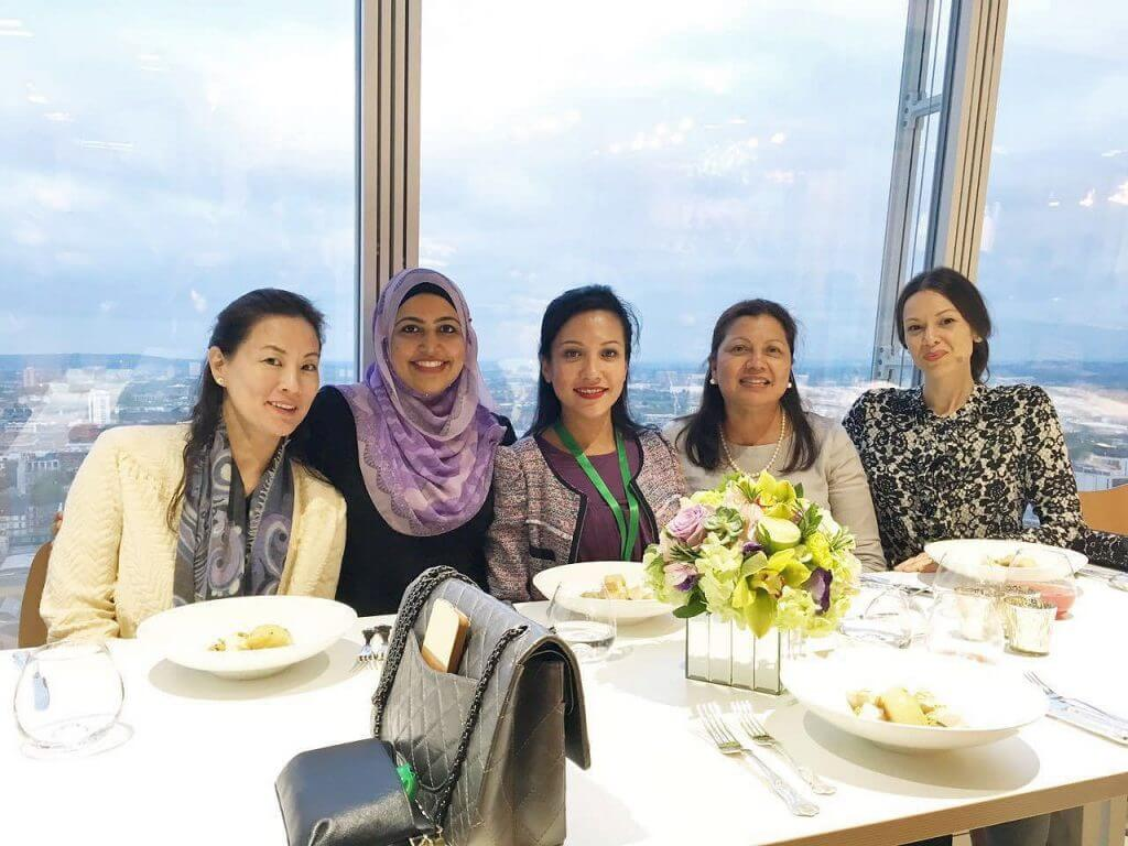 Group of 5 women enjoying lunch in a restaurant with views