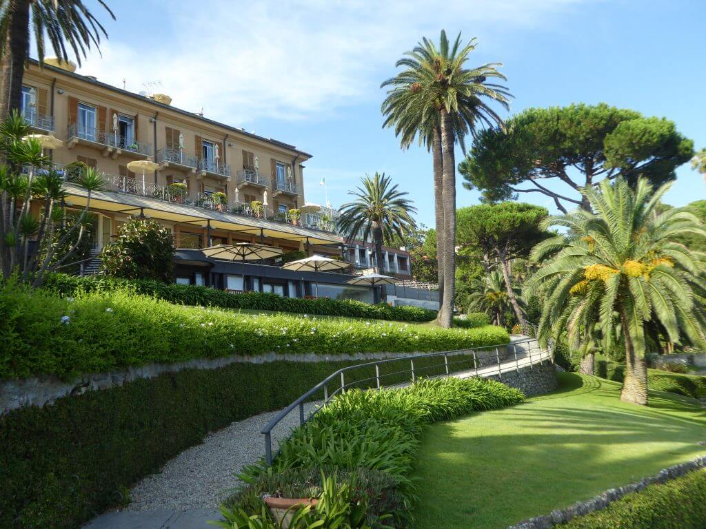 Beautiful hotel on a hill with palm trees in the gardn