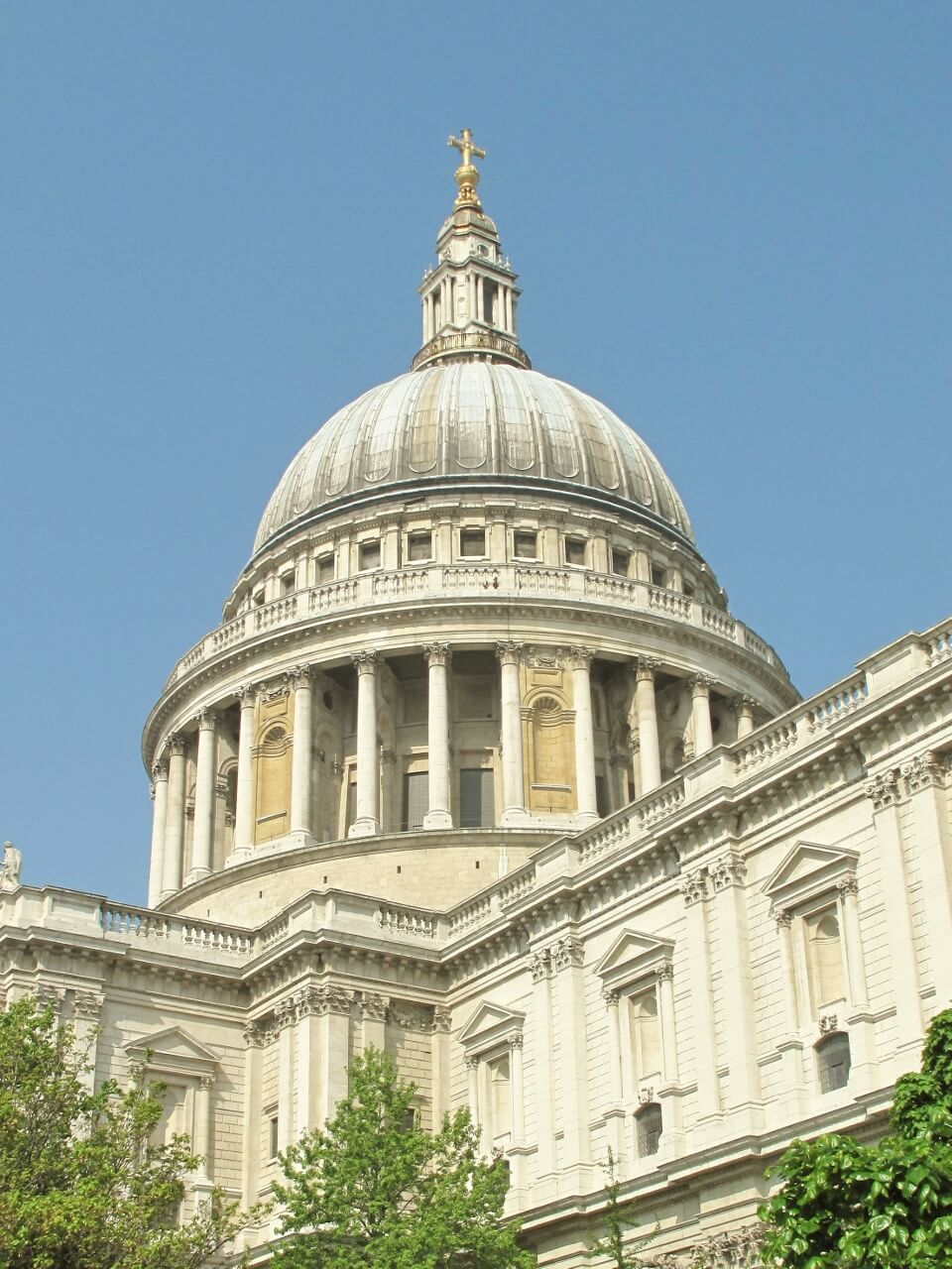 View of the dome of St Paul's Cathedral against a blue sky