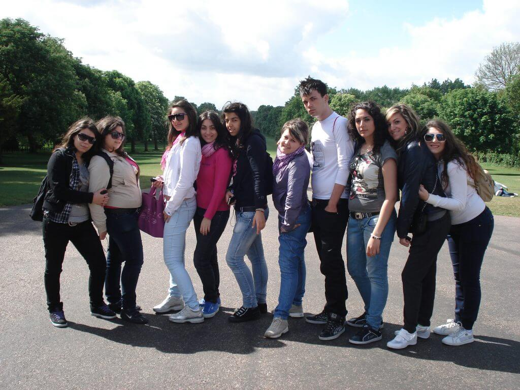 Group of teenage children on educational tour to Windsor