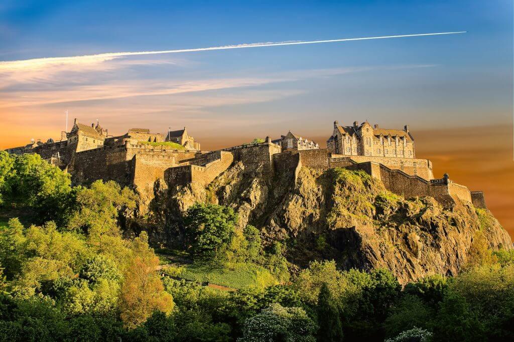 Edinburgh Castle perched on a rock at sunset